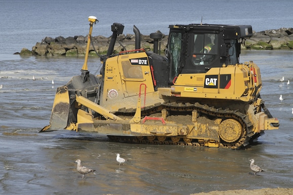 NORFOLK, Va. -- Norfolk District, U.S. Army Corps of Engineers' contractors from Great Lakes Dredging and Dock Company use bulldozers to push sand dredged from the bottom of the Chesapeake Bay into place along Norfolk, Virginia's Ocean View Beach. The sand is part of a $34.5 million project to reduce storm damage risk to infrastructure along a 7.3 mile stretch of waterfront, which is susceptible to damage during costal storms. Once complete, the beach will be 60 feet wide and slope up to 5 feet above mean low water. (U.S. Army photo/Patrick Bloodgood)