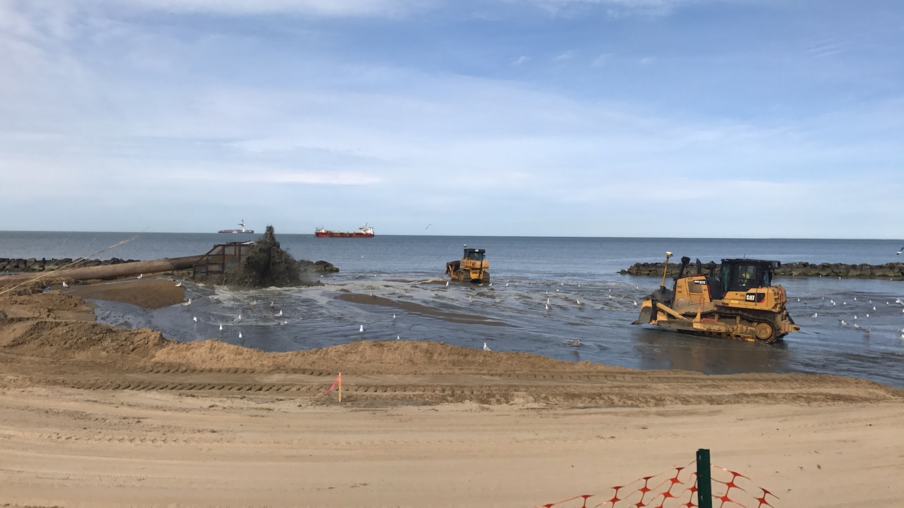 NORFOLK, Va. -- Norfolk District, U.S. Army Corps of Engineers' contractors from Great Lakes Dredging and Dock Company pump sand dredged from the bottom of the Chesapeake Bay up to Norfolk, Virginia's Ocean View Beach. The sand is part of a $34.5 million project to reduce storm damage risk to infrastructure along a 7.3 mile stretch of waterfront, which is susceptible to damage during costal storms. Once complete, the beach will be 60 feet wide and slope up to 5 feet above mean low water. (U.S. Army photo/Patrick Bloodgood)