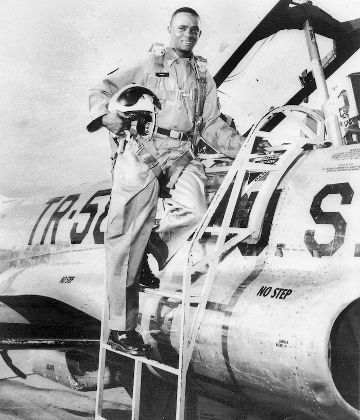Capt. Lorenza Conner, fighter pilot in the Vietnam War, climbing aboard an aircraft. Conner attended Tuskegee Institute (now Tuskegee University) and graduated with honors as a second lieutenant in ROTC.