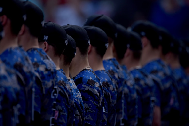 The U.S. Air Force Academy Falcons stand in formation during the presentation of the colors during the Freedom Classic baseball series, Feb. 25, 2017 at Grainger Stadium in Kinston, North Carolina. The Falcons scored seven hits in the championship game, and rallied a 3-2 win in 10 innings. (U.S. Air Force photo by Airman 1st Class Victoria Boyton)