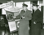 Defense Supply Agency Director Army Lt. Gen. Andrew McNamara visits the DSA offices in Battle Creek, Michigan, for the dedication of the Defense Logistics Services Center in February 1963.