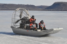 FRONTENAC, Minn. –Brandon Olson works the auger and Thomas Burrows, both St. Paul District channels and harbors, measures the ice at the Mississippi River's Lake Pepin Feb. 15. Starting at around 8:15 a.m. at Camp Lacupolis, crew members rode an airboat to various points of the lake and used an auger to drill through the ice. They then measured the thickness of the ice through the holes. They said the thickest ice measured 17 inches, located about 1 mile southeast of Lake City. But that quickly changed just 3 miles north of Lake City, where the crew encountered open water. – USACE photos by John Barker