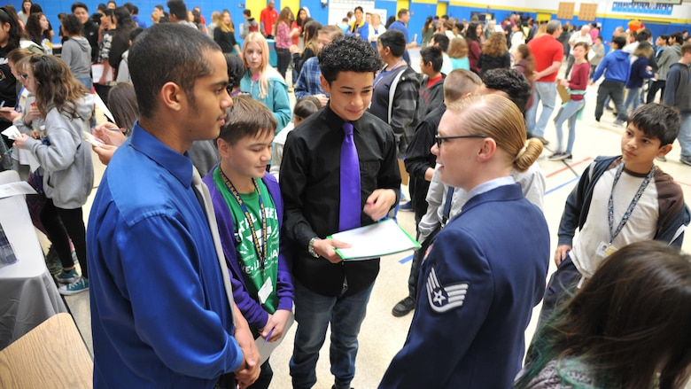 Staff Sgt. Cali Anthony, Military Personnel Section's NCOIC of Relocations, speaks with students of Grant Middle School during a career and college fair Feb. 21 in hopes of inspiring students to consider a military career.