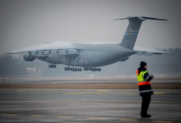 An Air Mobility Command C-5M Super Galaxy lands at Riga International Airport, Latvia, Mar. 1, 2017, to deliver UH-60 Black Hawk helicopters for the U.S. Army in support of Operation Atlantic Resolve. Five Black Hawk helicopters will be deployed to Latvia as part of a larger contingent of helicopters and personnel deployed to support Operation Atlantic Resolve, a U.S. commitment to maintaining peace and stability in the European region. (U.S. Air Force photo/Tech. Sgt. Ryan Crane)