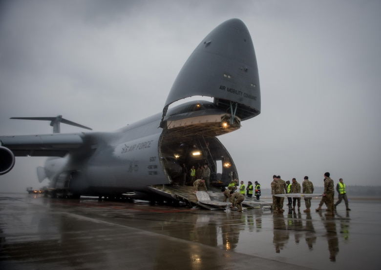 A U.S. Army UH-60 Black Hawk helicopter is unloaded from an Air Mobility Command C-5M Super Galaxy at Riga International Airport, Latvia, Mar. 1, 2017. Five Black Hawk helicopters will be deployed to Latvia as part of a larger contingent of helicopters and personnel deployed to support Operation Atlantic Resolve, a U.S. commitment to maintaining peace and stability in the European region. (U.S. Air Force photo/Tech. Sgt. Ryan Crane)