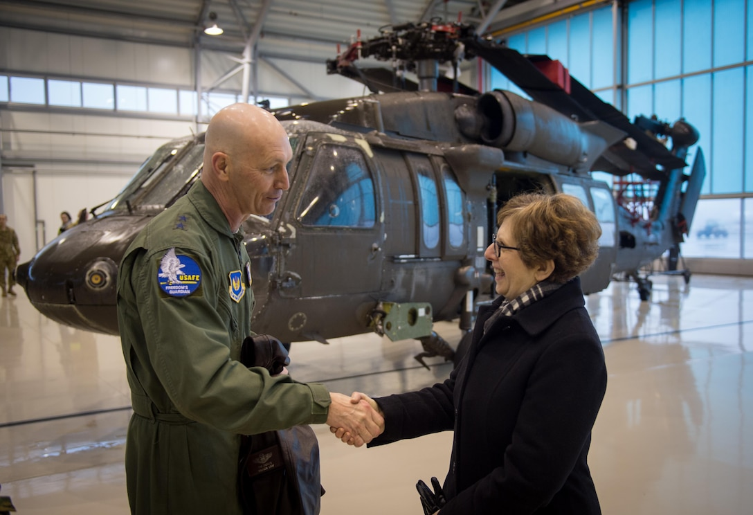 Maj. Gen. Timothy Zadalis thanks U.S. Ambassador to Latvia, Nancy Bikoff Pettit, for welcoming the U.S. military to Latvia during an event at Riga International Airport, Mar. 1, 2017. A U.S. Air Force C-5M Super Galaxy delivered UH-60 Black Hawks for the U.S. Army in Latvia. Five Black Hawk helicopters will be deployed to Latvia as part of a larger contingent of helicopters and personnel deployed to support Operation Atlantic Resolve, a U.S. commitment to maintaining peace and stability in the European region. (U.S. Air Force photo/Tech. Sgt. Ryan Crane)