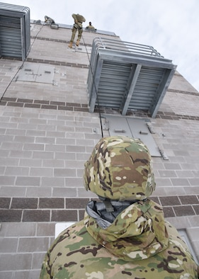 Airman Evan Murphey takes his turn down the 30 foot wall during rappelling exercises Feb. 25 at the Cheyenne Fire Department training facility. The rappelling course is designed to train future Tactical Response Force members how to properly rappel to descend quickly into a launch facility in case of emergency. (U.S. Air Force Photo by Glenn S. Robertson)