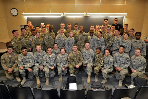 Army Brig. Gen. Charles Hamilton, Defense Logistics Agency Troop Support commander, stands with ROTC cadets at Rutgers University, New Brunswick, N.J., Feb. 23. He advised the cadets that to be successful, officers must ensure their units are highly fit, highly trained and highly disciplined.