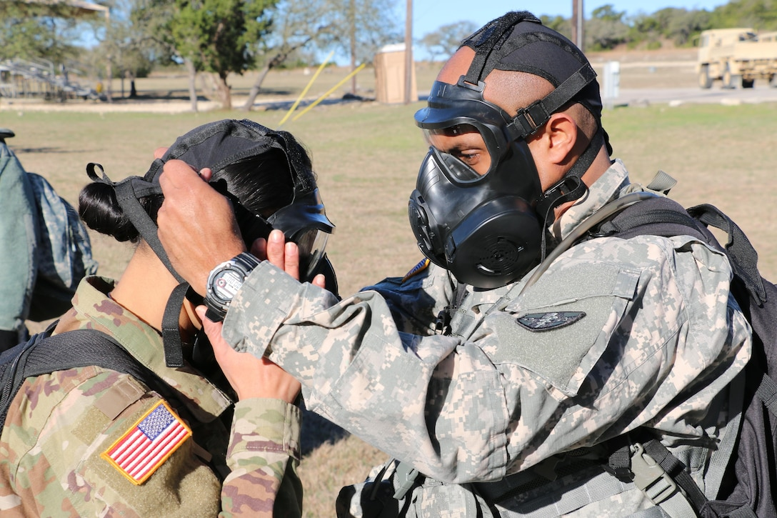 Sgt. 1st Class Billy Wilson II, Medical Readiness and Training Command, helps Spc. Sadiskshya Silwal, Western Medical Area Readiness Support Group, seal and clear her M-50 Joint Service General Purpose Mask to get ready for the Army Warrior Tasks portion of the Best Warrior Competition at Camp Bullis, Texas, 9 Feb.  Soldiers from the MRTC, Northeast MARSG, Southeast MARSG, Central MARSG and Western MARSG competed in the Best Warrior Competition for their respective commands at Camp Bullis, Texas, 8-12 Feb., 2017.