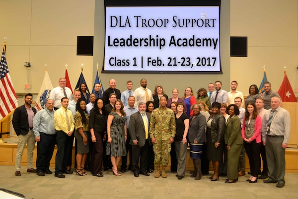 DLA Troop Support Commander Army Brig. Gen. Charles Hamilton (center) poses with the inaugural class of the organization's Leadership Academy Feb. 23 in Philadelphia. The three-day workshop was created to give new supervisors the tools needed to be effective leaders.