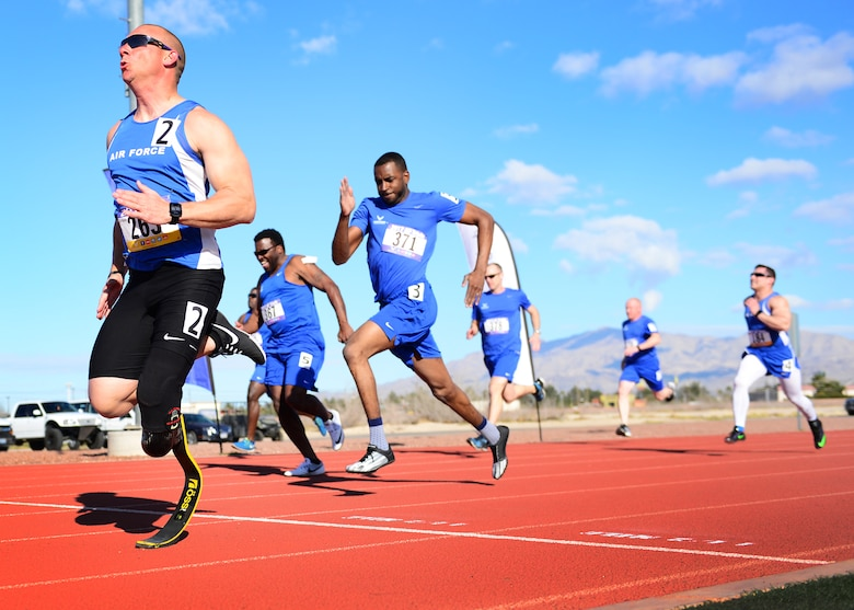 U.S. Air Force Tech. Sgt. Ben Seekell, 2017 AF Trials competitor, sprints to the finish of the 100 meter dash during Track and Field qualifications at the Warrior Fitness Center Feb. 28, 2017 at Nellis Air Force Base, Nev. During a 2011 improvised explosive device attack in Afghanistan, Seekell attributes his survival to the quick action of his teammates. (U.S. Air Force photo by Senior Airman Chip Pons)
