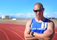 U.S. Air Force Tech. Sgt. Ben Seekell, 2017 AF Trials competitor, poses for a photo after the 1,500 meter run during Track and Field qualifications at the Warrior Fitness Center Feb. 28, 2017 at Nellis Air Force Base, Nev. During a 2011 improvised explosive device attack in Afghanistan, Seekell attributes his survival to the quick action of his teammates. (U.S. Air Force photo by Senior Airman Chip Pons)