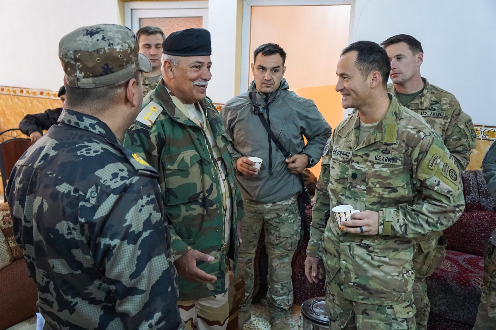U.S. Army Lt. Col. Jim Browning (right) speaks to a 9th Iraqi Army Division brigade commander before a review of the division's concept of operations for the upcoming battle to liberate West Mosul, Feb. 17, 2017.  Browning is the battalion commander of 2nd Battalion, 508th Parachute Infantry Regiment, 2nd Brigade Combat Team, 82nd Airborne Division and the Coalition advisor for the 9th IAD.   2nd BCT, 82nd Abn. Div. is deployed in support of Operation Inherent Resolve, to enable their Iraqi security forces partners through the advise and assist mission, contributing planning, intelligence collection and analysis, force protection, and precision fires to achieve the military defeat of ISIS.  Combined Joint Task Force-Operation Inherent Resolve is the global Coalition to defeat ISIS in Iraq and Syria. (U.S. Department of Defense photo by U.S. Marine Corps Capt. Timothy Irish)