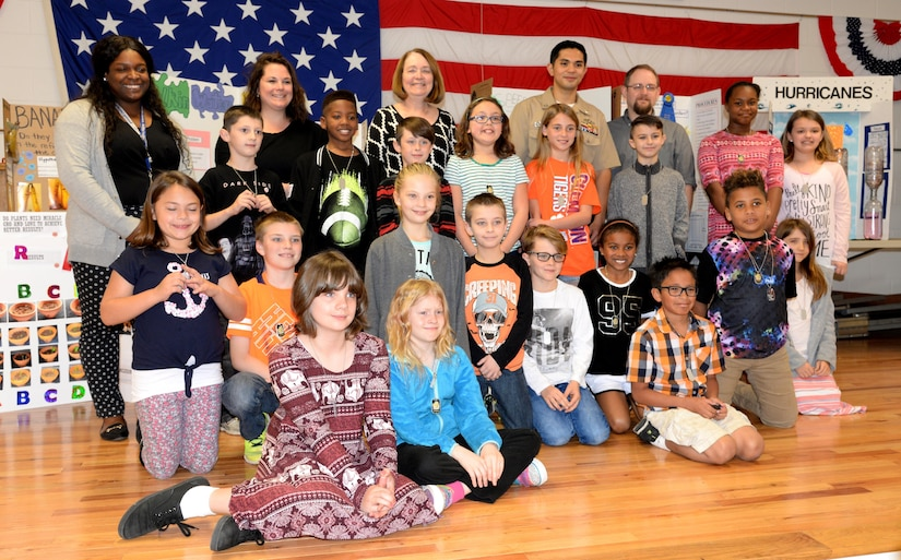 Fourth-grade students of Marrington Elementary (MNE) School pose for a photo with teachers and science fair judges following the MNE Science Fair Feb. 21, at Joint Base Charleston – Weapons Station.