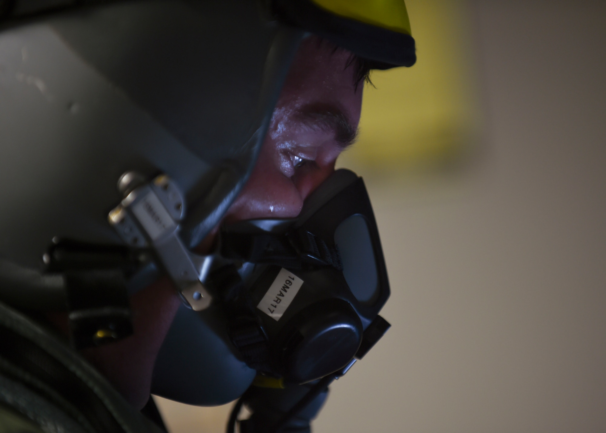 A pilot tests his oxygen mask before flying at Joint Base Langley-Eustis, Va., Feb. 27, 2017. Pilots tests their oxygen masks before each flight to ensure they are in working order providing safety for the entirety of their world-wide missions. (U.S. Air Force photo by Staff Sgt. Natasha Stannard)