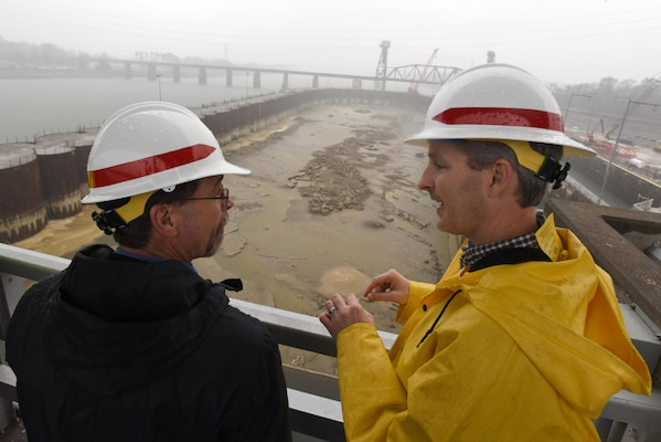 Adam Walker (Right), U.S. Army Corps of Engineers Nashville District project manager for the Chickamauga Lock Replacement Project, briefs Douglas Lamont, senior official performing duties of secretary of the Army for Civil Works, on the status of the work Feb. 28, 2017 in Chattanooga, Tenn. The Tennessee Valley Authority owns the dam while the Nashville District operates and maintains the current lock.