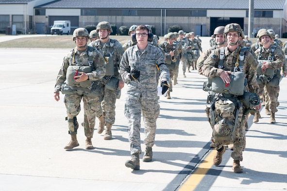 Airman 1st Class Patric Vuletich, a 43d Air Mobility Squadron Aerial Port passenger service agent, escorts nearly 60 U.S. Army paratroopers to a C-130 Hercules from the 317th Airlift Wing at Dyess Air Force Base, Texas, on Green Ramp here Feb. 28. Vuletich and numerous other Airmen from the 43d Air Mobility Operations Group supported visiting Air Mobility Command aircrews and Soldiers from Fort Bragg during Battalion Mass Tactical Week, held here Feb. 27 through March 2. (U.S. Air Force photo/Marc Barnes)