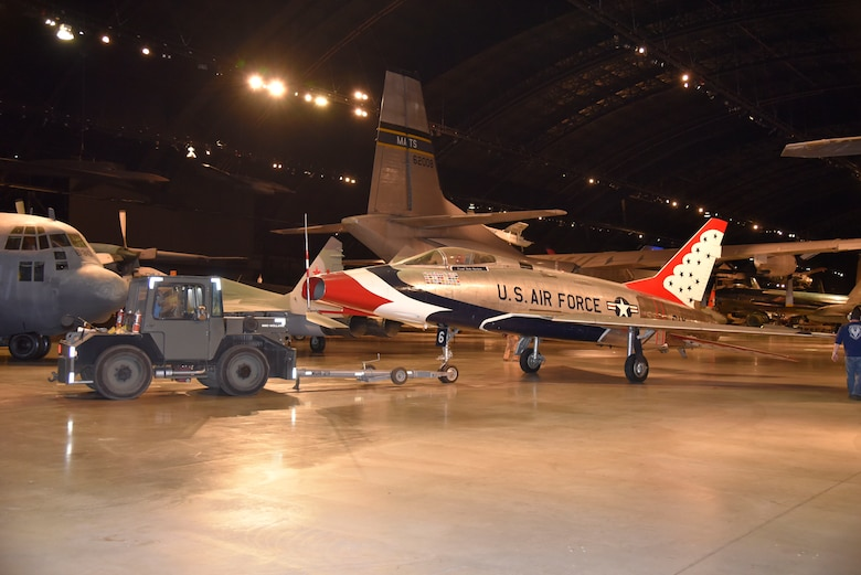 DAYTON, Ohio -- The North American F-100D Super Sabre  being moved into position in the Cold War Gallery at the National Museum of the United States Air Force. The restoration crew members worked as part of a team to complete the gallery reconfiguration on Jan. 26, 2017. (U.S. Air Force photo)