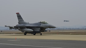 An F-16 Fighting Falcon assigned to the 36th Fighter Squadron taxis to the runway for a training mission while an A-10 Thunderbolt II from the 25th Fighter Squadron takes off during Exercise Beverly Herd 17-1 at Osan Air Base, Republic of Korea, March 1, 2017. Pilots from both fighter squadrons flew multiple sorties during exercise Beverly Herd, honing their flying skills and ability to work around the rugged ROK landscape.