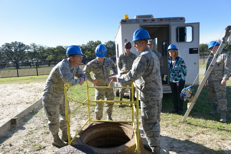 """A group of 85th Engineering Installation Squadron Airmen explain manhole entry procedures to Maj. Gen. Robert LaBrutta, 2nd Air Force commander, during a 2nd AF immersion tour of the unit located at Keesler Air Force Base, Miss., Feb. 9, 2017. The Airmen at the 85th EIS are part of the only active duty EIS in the Air Force. During contingencies, the 85th EIS Airmen can deliver their unique skills to the warfighter within 72 hours - anywhere in the world, which is why their motto is, """"With Pride, Worldwide!"""" (U.S. Air Force photo by Andre' Askew)"""