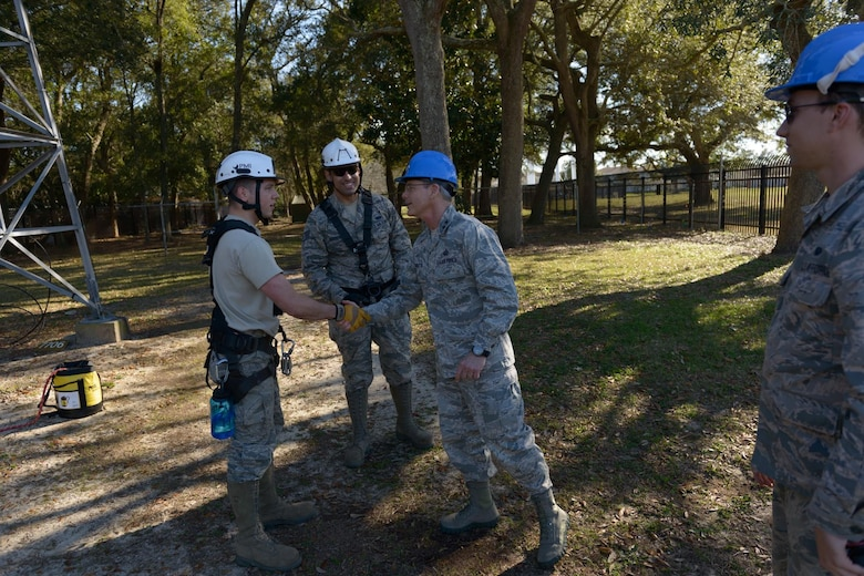 """Staff Sgt.  Wesley Schamberger, 85th Engineering Installation Squadron cable and antenna systems supervisor, introduces himself to Maj. Gen. Robert LaBrutta, 2nd Air Force commander, during a 2nd AF immersion tour of the unit located at Keesler Air Force Base, Miss., Feb. 9, 2017. The Airmen at the 85th EIS are part of the only active duty EIS in the Air Force. During contingencies, the 85th EIS Airmen can deliver their unique skills to the warfighter within 72 hours - anywhere in the world, which is why their motto is, """"With Pride, Worldwide!"""" (U.S. Air Force photo by Andre' Askew)"""