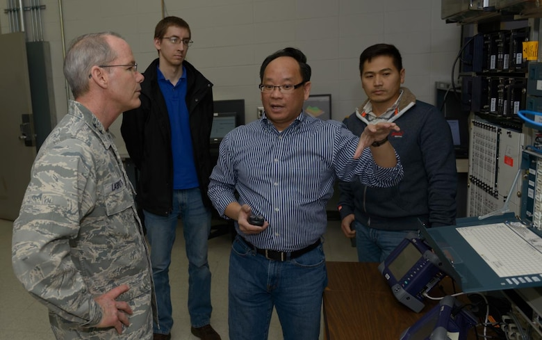"""Peter Bui, 85th Engineering Installation Squadron senior electronics engineer, explains network testing lab equipment to Maj. Gen. Robert LaBrutta, 2nd Air Force commander, during a 2nd AF immersion tour of the unit located at Keesler Air Force Base, Miss., Feb. 9, 2017. The Airmen at the 85th EIS are part of the only active duty EIS in the Air Force. During contingencies, the 85th EIS Airmen can deliver their unique skills to the warfighter within 72 hours - anywhere in the world, which is why their motto is, """"With Pride, Worldwide!"""" (U.S. Air Force photo by Andre' Askew)"""