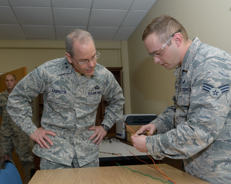 Senior Airman Micheal Turland, 85th Engineering Installation Squadron cable and antenna systems technician, explains opening fiber optic cable to Maj. Gen. Robert LaBrutta, 2nd Air Force commander, during a 2nd AF immersion tour of the unit located at Keesler Air Force Base, Miss., Feb. 9, 2017. The Airmen at the 85th EIS are part of the only active duty EIS in the Air Force. They are also the only organization in the Defense Department providing specialized engineering services such as electromagnetic hazard and interference investigations and High Altitude Electromagnetic Pulse protection. (U.S. Air Force photo by Andre' Askew)