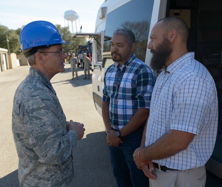 Maj. Gen. Robert LaBrutta, 2nd Air Force commander, discusses the 85th Engineering Installation Squadron mission with (front) Justin Johnston and _Alton Richards, 85th EIS electronic engineers during a 2nd AF immersion tour of the unit located at Keesler Air Force Base, Miss., Feb. 9, 2017. The Airmen at the 85th EIS are part of the only active duty EIS in the Air Force. They are also the only organization in the Defense Department providing specialized engineering services such as electromagnetic hazard and interference investigations and High Altitude Electromagnetic Pulse protection. (U.S. Air Force photo by Andre' Askew)