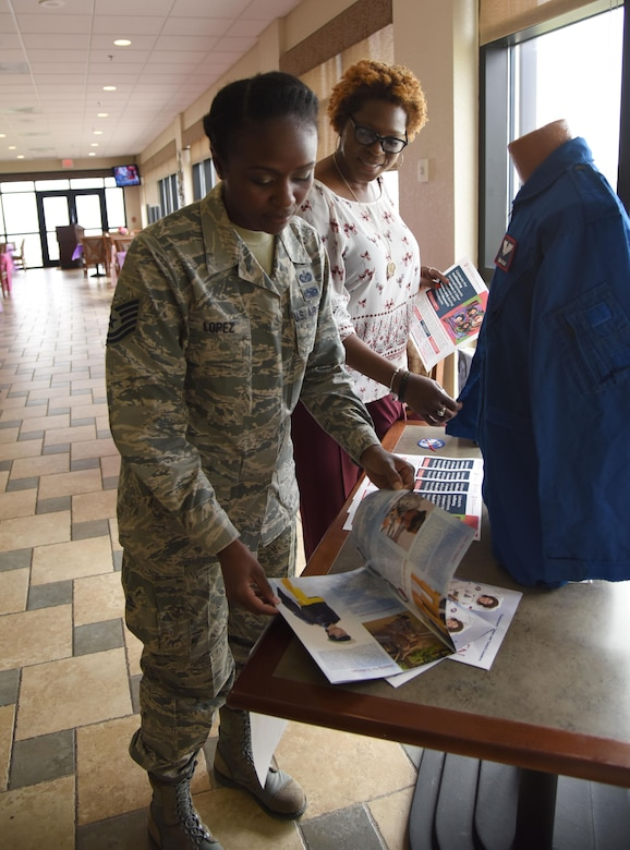 Tech. Sgt. Meshanda Lopez, 81st Training Wing special victims paralegal, and Ruby Bordley, 81st Force Support Squadron work life program technician, view women's heritage display items at the Bay Breeze Event Center March 1, 2017, on Keesler Air Force Base, Miss. The display was set up for viewing to begin Keesler's celebration of National Women's History Month. (U.S. Air Force photo by Kemberly Groue)