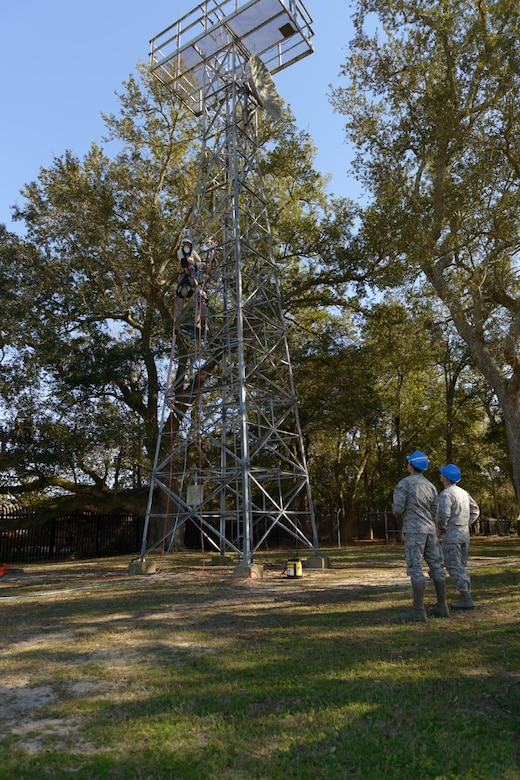 Maj. Gen. Robert LaBrutta, 2nd Air Force commander, and Senior Airman Chase Kiefer, 85th Engineering Installation Squadron cable and antenna systems technician, discuss tower rescue procedures during a 2nd AF immersion tour of the unit located at Keesler Air Force Base, Miss., Feb. 9, 2017. The Airmen at the 85th EIS are part of the only active duty EIS in the Air Force. They are also the only organization in the Defense Department providing specialized engineering services such as electromagnetic hazard and interference investigations and High Altitude Electromagnetic Pulse protection. (U.S. Air Force photo by Andre' Askew)