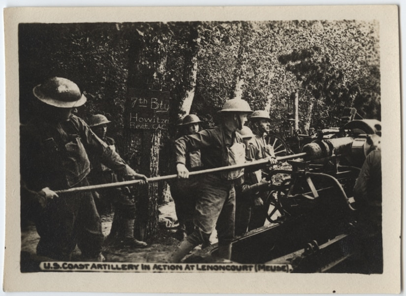 Sailors of the 7th Battery of the Howitzer Regiment of the U.S. Coastal Artillery clean their gun during operations in France during World War I. Photo courtesy of the National World War I Museum and Memorial