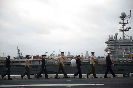 Marines and sailors with the 24th Marine Expeditionary Unit man the rails as amphibious assault ship USS Bataan (LHD 5) prepares to go underway for deployment March 1, 2017. The 24th MEU will operate in Europe and the Middle East in the coming months providing crisis response and contingency support for combatant commanders, including maritime security operations, humanitarian assistance, and advance force operations. (U.S. Marine Corps photo by Lance Cpl. Autmn Bobby)