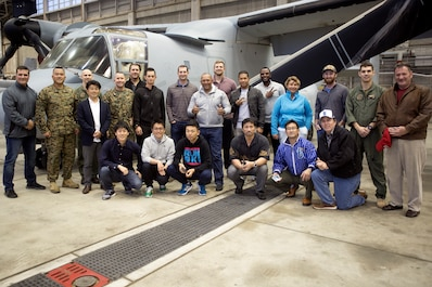 """Marines and Yokohama DeNA BayStars baseball team pose in front of an MV-22B Osprey Feb. 23 on Marine Corps Air Station Futenma, Okinawa, Japan. The BayStars players and staff had the opportunity to tour an Osprey and dine at the Habu Pit. """"Events like this enhance the already strong community relations MCAS Futenma enjoys with the surrounding City of Ginowan,"""" said Lt. Col. Bob Sweginnis, the executive officer of MCAS Futenma. """"This event in particular allowed those who live and work aboard MCAS Futenma to meet and interact with professional baseball players from a prominent Japanese Big League team that conducts spring training every year in here Ginowan City, just outside the gates of Futenma.""""  (U.S. Marine Corps Photo by Cpl. Jessica Collins)"""