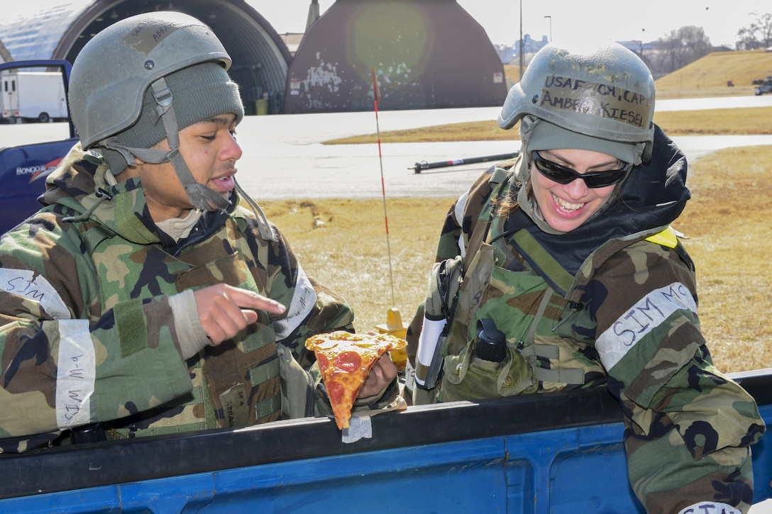 U.S. Air Force Senior Airman Kyron Abraham, thanks U.S. Air Force Chap. (Capt.) Amber Kiesel, 51st Fighter Wing chaplain, for the food and drink she brought out to the flightline during Exercise Beverly Herd 17-1 at Osan Air Base, Republic of Korea, March 2, 2017. Kiesel and other members of the 51st FW chapel staff went across the base with offers of food and drink to help keep morale up during the exercise. (U.S. Air Force photo by Staff Sgt. Victor J. Caputo)