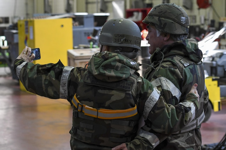U.S. Air Force Chap. (Lt. Col.) Jeffrey Granger, 51st Fighter Wing wing chaplain, takes a selfie with a member of the 51st Maintenance Squadron aerospace ground equipment shop during Exercise Beverly Herd 17-1 at Osan Air Base, Republic of Korea, March 2, 2017. Granger and other members of the 51st FW chapel staff went across the base with offers of food and drink to help keep morale up during the exercise. (U.S. Air Force photo by Staff Sgt. Victor J. Caputo)