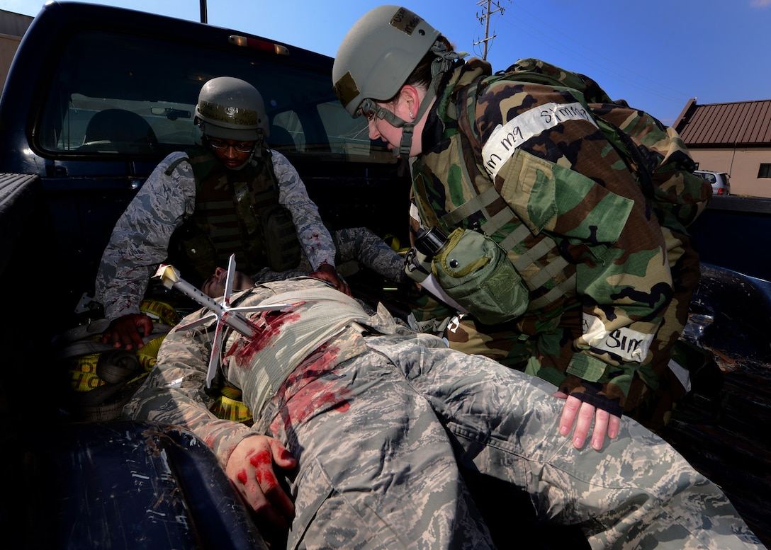 Role players take part in a simulated unexploded ordnance victim scenario during Exercise Beverly Herd 17-1 at Osan Air Base, Republic of Korea, March 2, 2017. During this scenario the  surgeon was required to remove the UXO and safely hand it over to the 51st Civil Engineer Squadron explosive ordnance disposal team for further disposal. (U.S. Air Force photo by Airman Gwendalyn Smith)