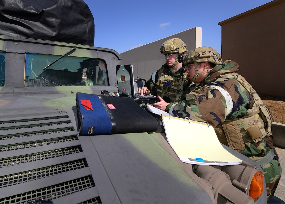 "U.S. Air Force Staff Sgt. Alex Gaunt (right), 51st Civil Engineer Squadron explosive ordnance disposal sergeant and Airman 1st Class Cody Stevenson(left), 51st CES explosive ordnance disposal apprentice discuss proper ways to dispose and remove an unexploded ordinance from a simulated patient's abdomen during Exercise Beverly Herd 17-1 at Osan Air Base, Republic of Korea, March 2, 2017. The scenario was based off of a real-world situation that happened in the Middle East, painting a realistic picture of war that highlighted the importance of being prepared and ready to ""Fight Tonight."" (U.S. Air Force photo by Airman Gwendalyn Smith)"