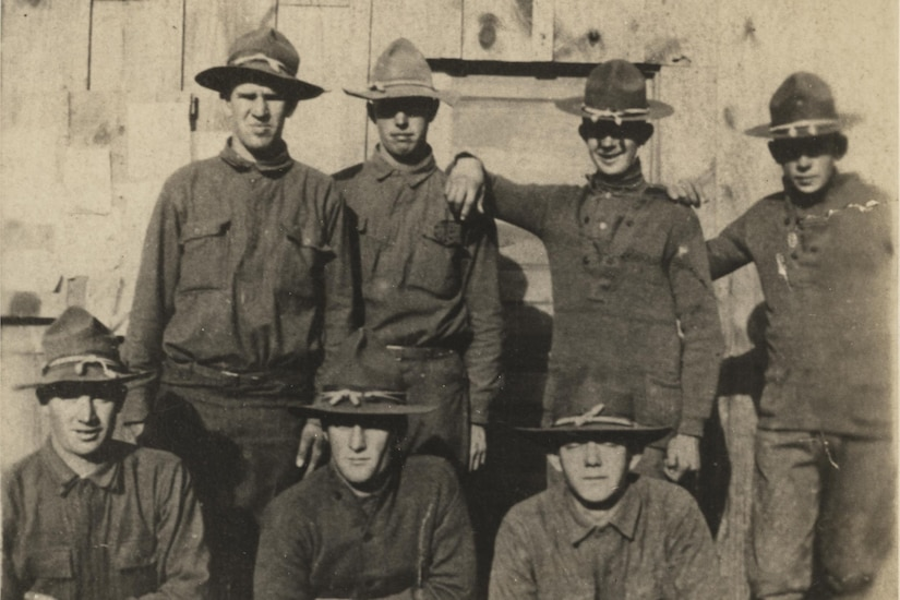 Doughboys of Company G, 137th Infantry Regiment, 35th Division pose in front of a barracks in France in 1918. The soldier in the front row – Pvt. John Frary – was killed in the Meuse-Argonne campaign. Photo courtesy of the National World War I Museum and Memorial