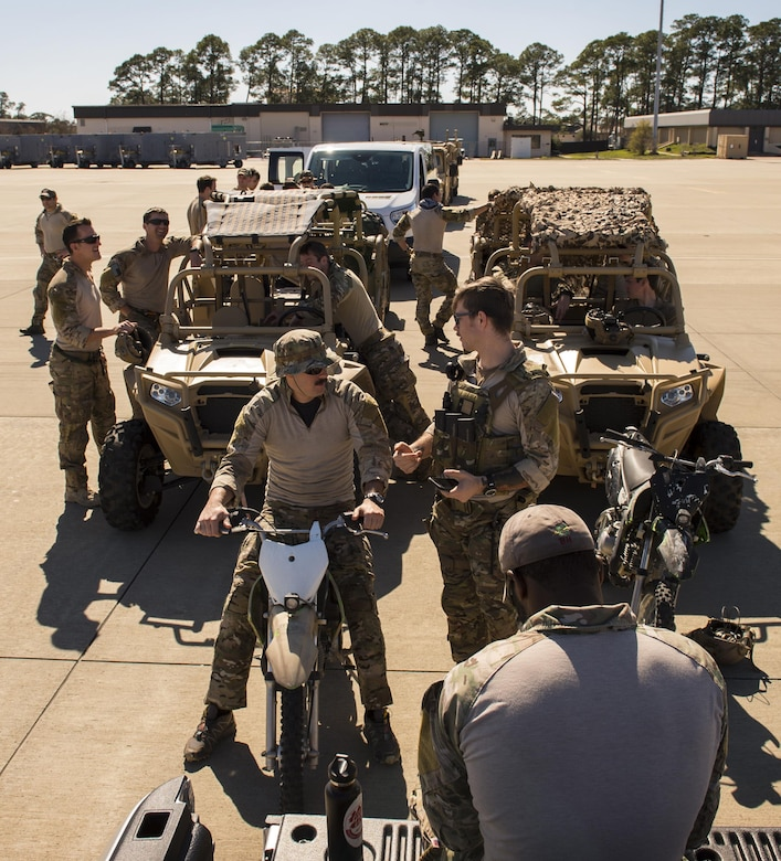 U.S. Air Force Airmen from the 24th Special Operations Wing form a line before entering an MC-130J Commando II while participating in a static load training during Exercise Emerald Warrior at Hurlburt Field, Fla., Feb. 26, 2017.  Emerald Warrior is the largest joint special operations exercise. U.S. Special Operations Command forces train to respond to various threats across the spectrum of conflict. (U.S. Air Force photo by Senior Airman Erin Piazza)