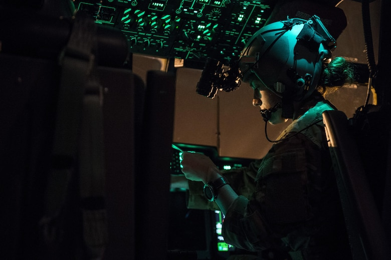 A U.S. Air Force 9th Special Operations Squadron pilot reads through a checklist after a flight on an MC-130J Commmando II during Emerald Warrior 17 at Hurlburt Field, Fla., Feb. 28, 2017. Emerald Warrior is a U.S. Special Operations Command exercise during which joint special operations forces train to respond to various threats across the spectrum of conflict. (U.S. Air Force photo by Staff Sgt. Corey Hook)