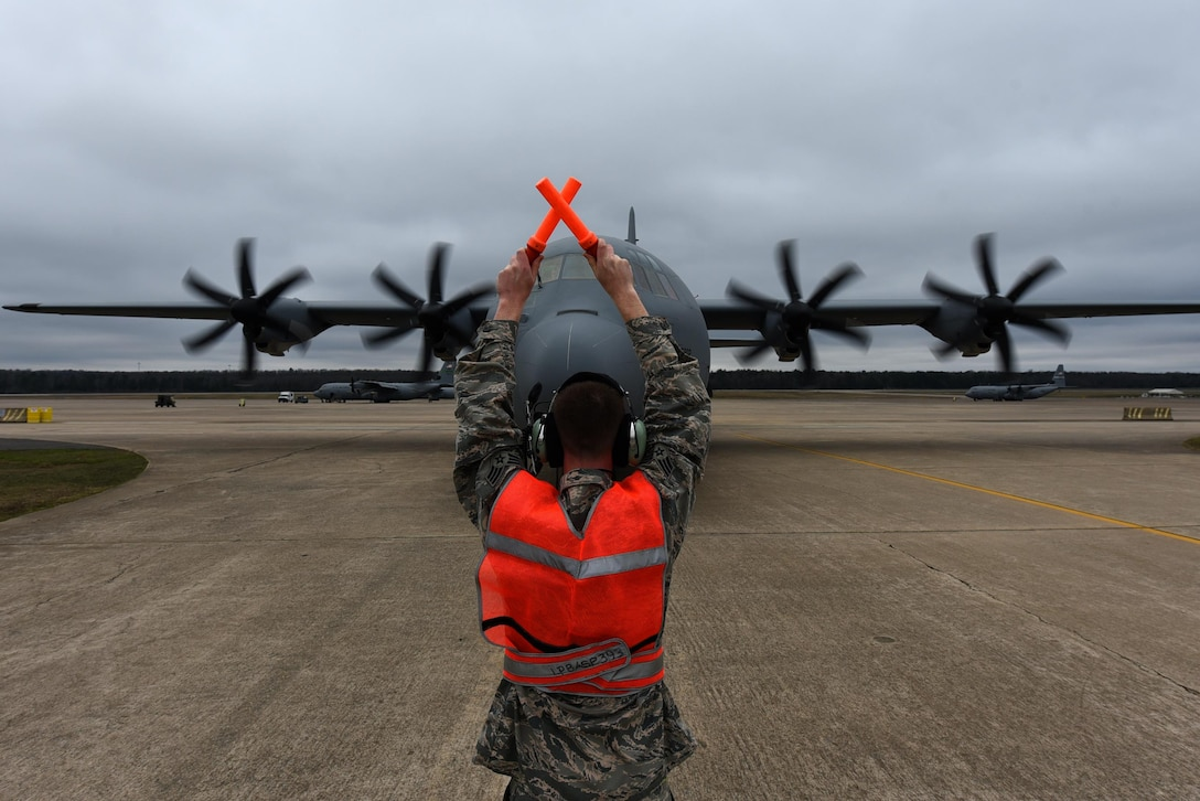 A 314th Aircraft Maintenance Squadron Airman marshals a C-130J delivered from the Lockheed Martin facility Feb. 27, 2017, at Little Rock Air Force Base, Ark. U.S. Air Force Maj. Gen. James Hecker, 19th Air Force commander, delivered the final new C-130J to the 314th Airlift Wing's fleet, completing the H- to J-model transition for the wing. (U.S. Air Force photo by Airman 1st Class Kevin Sommer Giron)