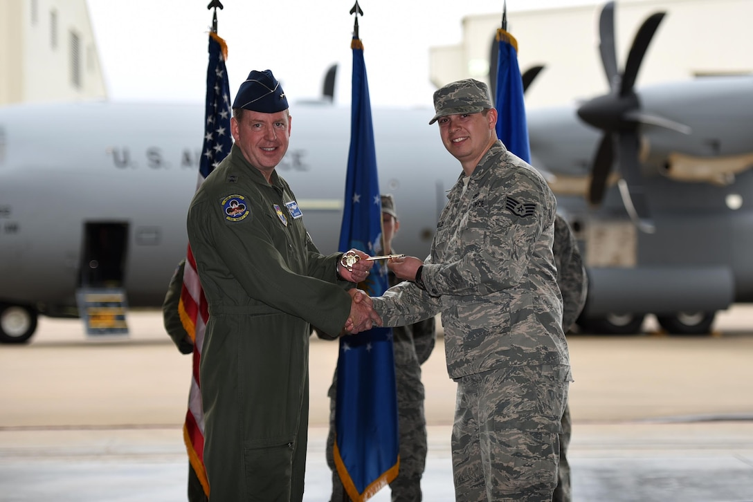 U.S. Air Force Maj. Gen. James Hecker, 19th Air Force commander, presents a ceremonial C-130J key to U.S. Air Force Staff Sgt. Joshua Shields, 314th Aircraft Maintenance Squadron C-130J crew chief, Feb. 27, 2017, at Little Rock Air Force Base, Ark. Hecker delivered the 14th and final C-130J to the 314th Airlift Wing fleet, completing the transition from the H- to J-model. (U.S. Air Force photo by Airman 1st Class Kevin Sommer Giron)