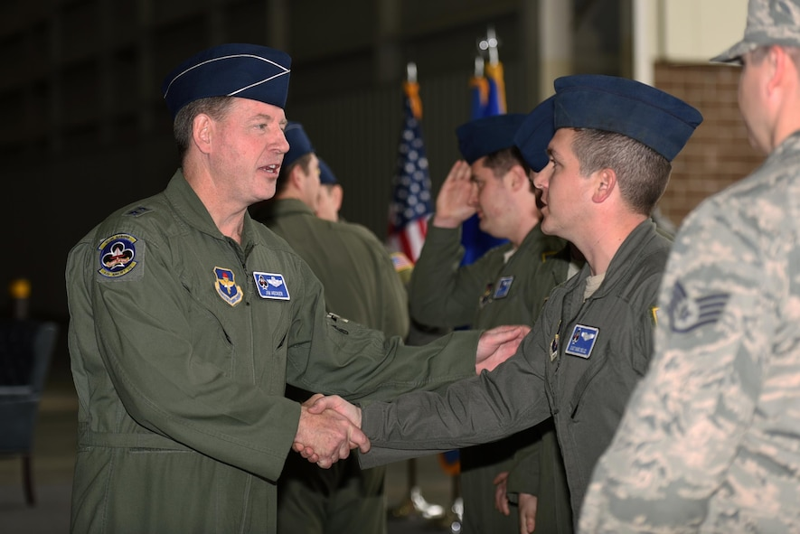 U.S. Air Force Maj. Gen. James Hecker, 19th Air Force commander, congratulates the aircrew and maintainers of the C-130J delivery team Feb. 27, 2017, at Little Rock Air Force Base, Ark. The aircrew members aided in the delivery of the newest C-130J to the 314th Airlift Wing fleet. (U.S. Air Force photo by Airman 1st Class Kevin Sommer Giron)