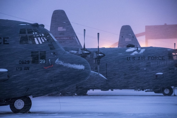 179th Airlift Wing Maintenance members prep the fleet of C-130H Hercules as a blanket of snow descends on them Feb. 9, 2017, at the 179th Airlift Wing, Mansfield, Ohio.  The 179th Airlift Wing is always on mission to be the first choice to respond to community, state and federal missions with a trusted team of highly qualified Airmen. (U.S. Air National Guard photo by 1st Lt. Paul Stennett/Released)