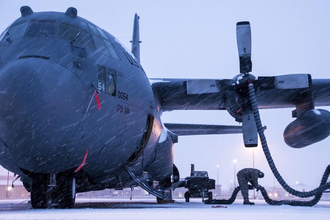 179th Airlift Wing Maintenance members prep the fleet of C-130H Hercules as a blanket of snow decends on them Feb. 9, 2017, at the 179th Airlift Wing, Mansfield, Ohio.  The 179th Airlift Wing is always on mission to be the first choice to respond to community, state and federal missions with a trusted team of highly qualified Airmen. (U.S. Air National Guard photo by 1st Lt. Paul Stennett/Released)