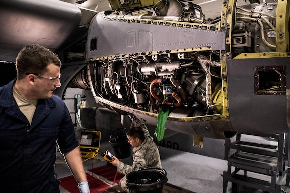 Staff Sgt. Anthony Balsley from the 179th Airlift Wing, Mansfield, Ohio changes filters on an engine of a C-130H Hercules while Master Sgt. Chris Antram conducts a borescope inspection during an isochronal inspection Feb. 10, 2017.  The 179th Airlift Wing is always on a mission to be the first choice to respond to community, state and federal missions with a trusted team of highly qualified Airmen. (U.S. Air National Guard photo by 1st Lt. Paul Stennett\Released)