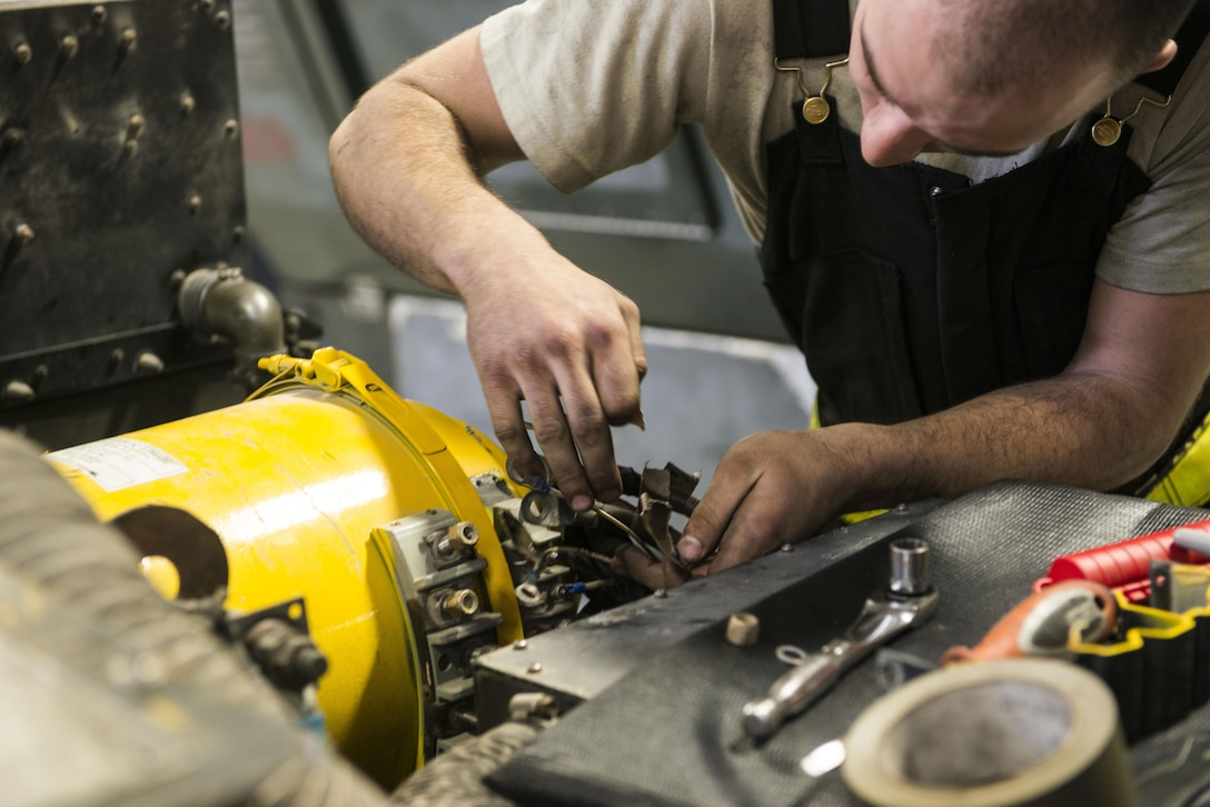 Senior Airman Kyle Hughes, 366th Aerospace Ground Equipment maintenance, changes the generator of a -60 February 28, 2017, at Mountain Home Air Force Base, Idaho. The -60 is a turbine engine that provides bleed air to an air conditioning unit, which in turn pushes air to the aircraft. (U.S. Air Force photo by Senior Airman Malissa Lott/Released)