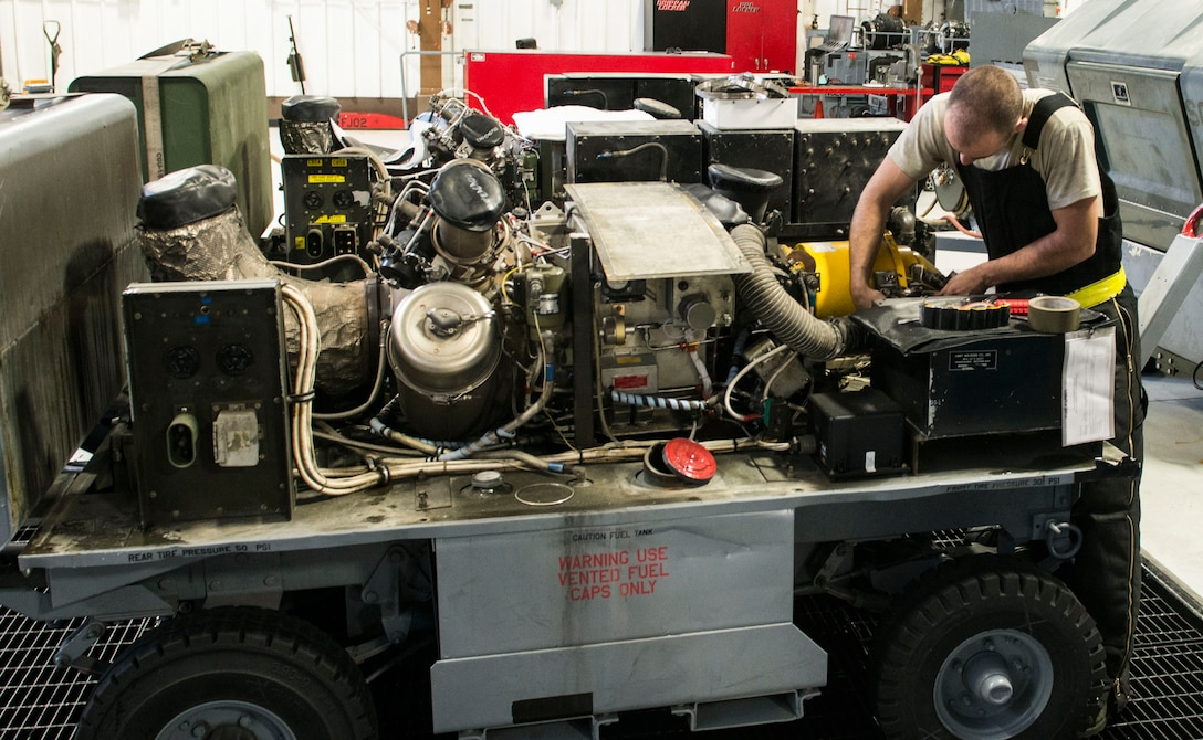 Senior Airman Kyle Hughes, 366th Aerospace Ground Equipment maintenance, changes the generator of a -60 February 28, 2017, at Mountain Home Air Force Base, Idaho. While most of the equipment AGE airmen work on is meant for flightline operations, their equipment can also support the needs of other agencies on base. (U.S. Air Force photo by Senior Airman Malissa Lott/Released)