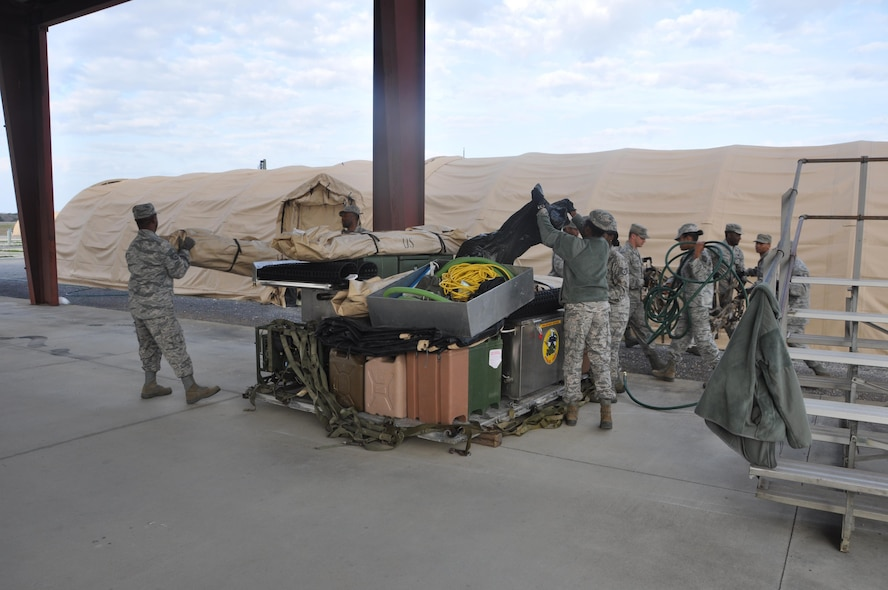 Members of the 908th Airlift Wing's Force Support Squadron unload a pallet at the start of the Hennessy Competition Feb. 11 at Maxwell Air Force Base. The 908th is one of four teams competing for the John L. Hennessy Award that recognizes those who best excel in food service. (U.S. Air Force photo by Bradley J. Clark)