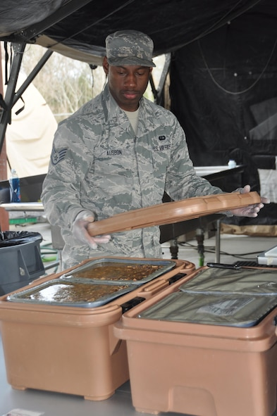 Staff Sgt. Octavius Ausbon, member of the 908th Airlift Wing's Force Support Squadron, prepares to cover food during the Hennessy Competition Feb. 11 at Maxwell Air Force Base. Ausbon won the individual Outstanding Performer award last year while competing for the John L. Hennessy Award that recognizes those who best excel in food service. (U.S. Air Force photo by Bradley J. Clark